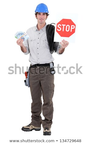 Electrician holding cash and stop sign Stock photo © photography33