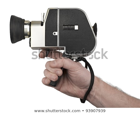 Old 8mm movie camera in hand Stock photo © artush
