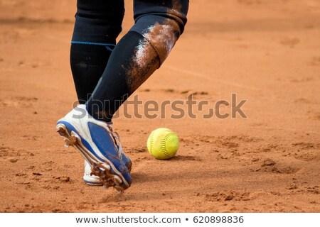 Foto d'archivio: Softball Player Fielding A Ground Ball