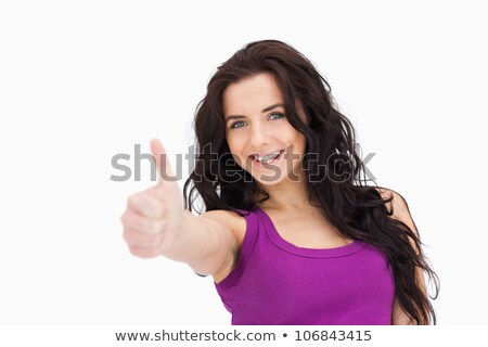 Stock photo: Blue eyed woman the thumb-up agaisnt white background