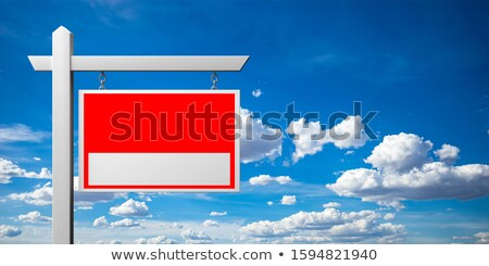 blank white real estate sign on a blue sky stock photo © lightsource