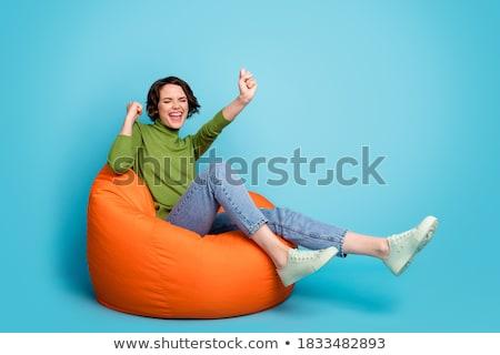 mosolyog · lány · fotel · vonzó · mosolygó · nő · fekete - stock fotó © kalozzolak