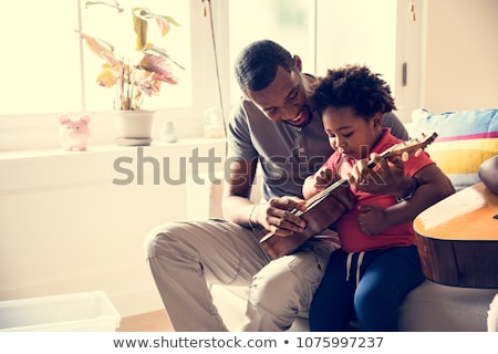 father and son playing music stock photo © photography33