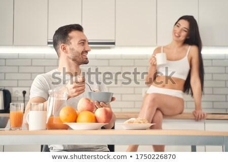 Young brunette man with his charming wife Stock photo © konradbak