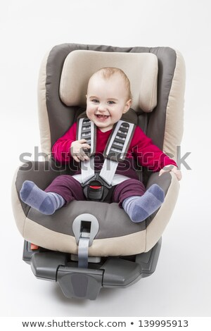 Сток-фото: Happy Child In Booster Seat For A Car In Light Background