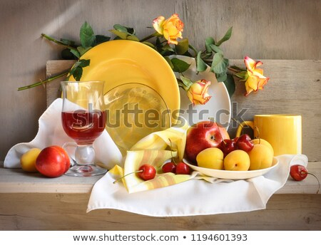 retro still life with kitchen utensils and fruits stock photo © tolokonov