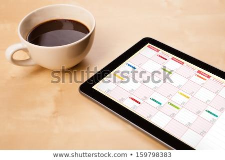 Tablet kahve gündem dijital fincan açmak Stok fotoğraf © luminastock