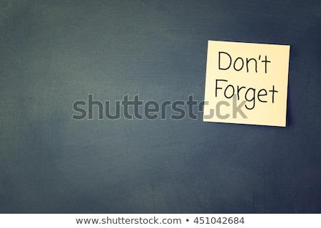 do not forget yellow sticker on bulletin stock photo © tashatuvango