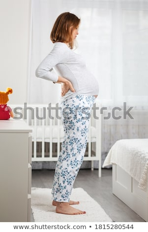 a young pregnant woman is experiencing the discomfort of pregnan stock photo © dacasdo