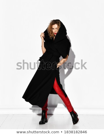 woman in leather pants posing by holding her collar  Stock photo © feedough