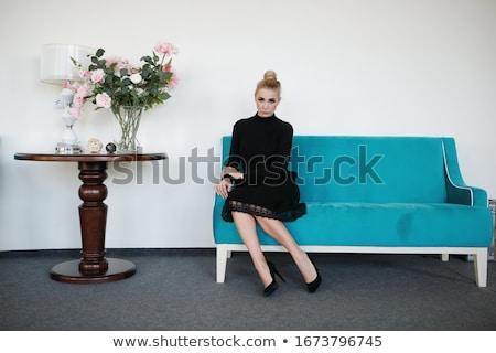 小さな ブロンド 女性 黒のドレス 座って ベッド ストックフォト © utorro