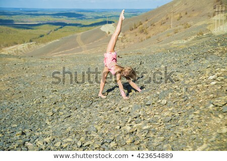 Mystic pictures, ballet dancer stands on the cliff edge Stock photo © Geribody