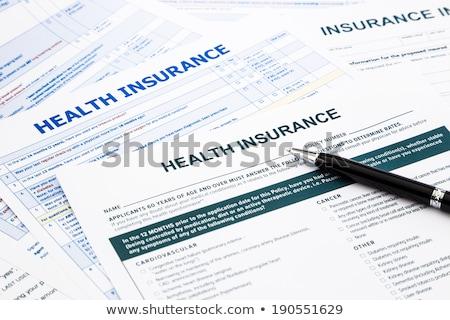 Egészségbiztosítás irányvonal irat számológép Stock fotó © devon