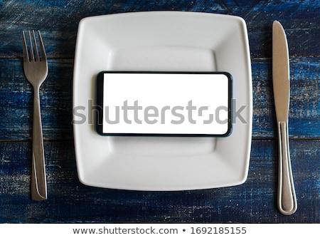 Mobile smart phone served as dinner on white plate Stock photo © stevanovicigor