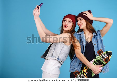 woman taking self picture with smartphone camera Stock photo © dolgachov