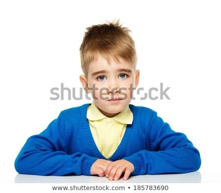 Nadenkend weinig jongen Blauw cardigan Geel Stockfoto © Nejron