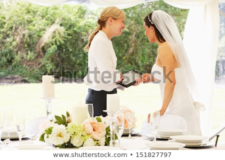 bride with wedding planner in marquee stock photo © monkey_business