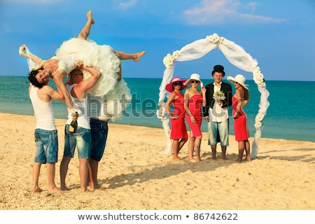 Stockfoto: Bridesmaid Standing On Beach At Wedding Ceremony