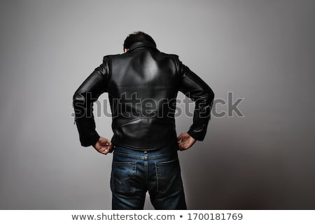 Young man wearing black leather jacket Stock photo © stockyimages