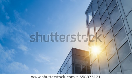 clouds reflected in windows of modern office building stock photo © amok