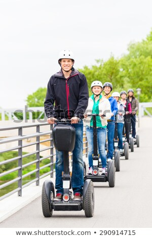 Tourist group having guided Segway city tour  Stock photo © Kzenon