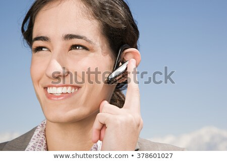 Business woman with phone bluetooth headset smiling Stock photo © diego_cervo