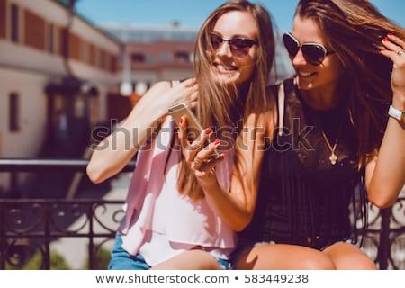 gelukkig · jong · meisje · stad · glimlachend · kind · permanente - stockfoto © Kor