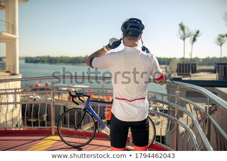 Stockfoto: Happy Athletic Man With Hands On Back Of His Head