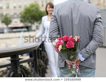 Man ready to give flowers to girlfriend Stock photo © Witthaya