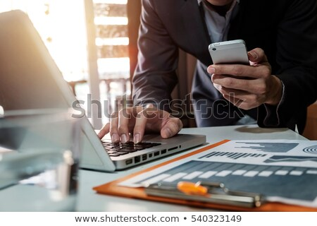 businessman working with digital tablet report charts on desk stock photo © simpson33