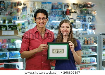 happy chinese man showing first dollar earning in computer shop stock photo © diego_cervo