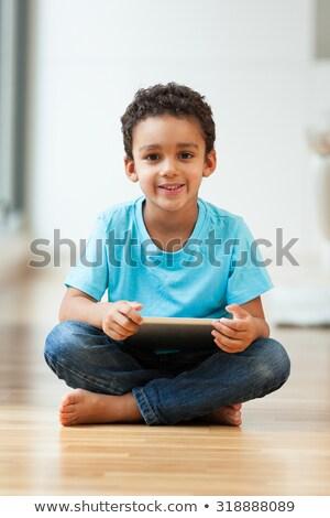 Aranyos férfi gyerek ül padló tabletta Stock fotó © ozgur
