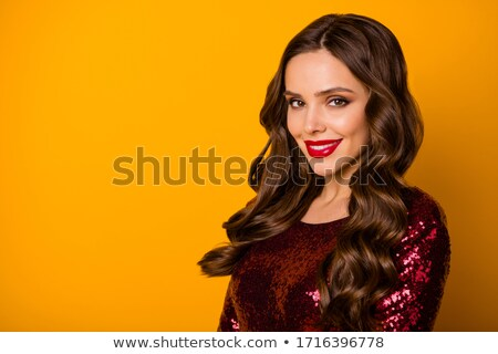 Beautiful Girl in Red Sequin Dress Looking in the Mirror Stock photo © NicoletaIonescu