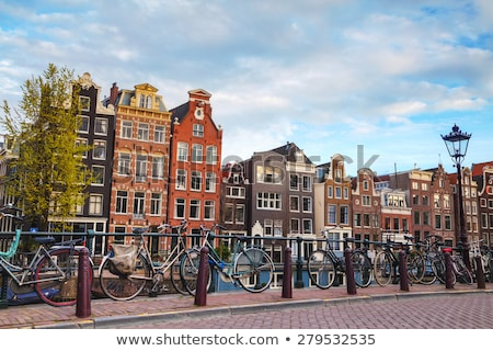 Stock photo: Bicycles parked on a bridge in Amsterdam