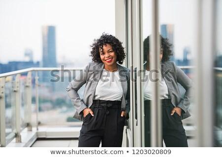 Empresária em pé mãos bolso branco negócio Foto stock © wavebreak_media