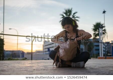 Lány keres valami hátizsák fiatal gyönyörű lány Stock fotó © deandrobot