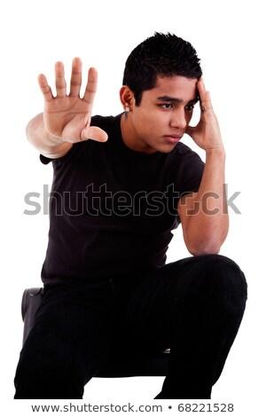 Jeunes homme pensive main arrêter signal Photo stock © alexandrenunes