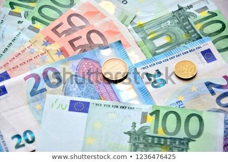 Euro banknotes and coins Stock photo © jordanrusev
