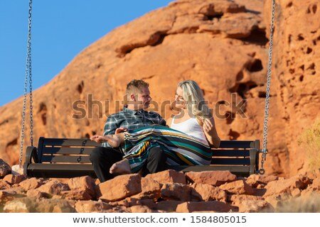 woman looks at  man while he sits on her lap Stock photo © feedough