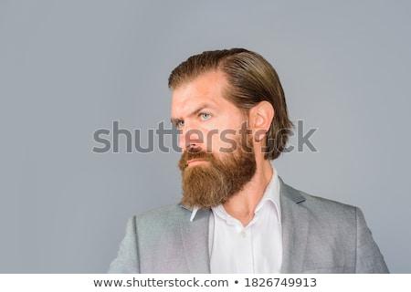 Sério homem barba cabelos longos retrato olhando Foto stock © deandrobot