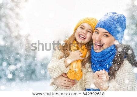 Mãe criança menina inverno andar família feliz Foto stock © choreograph
