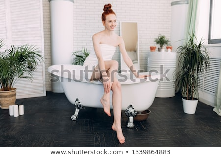 Kadın bornoz oturma banyo portre Stok fotoğraf © deandrobot