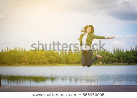 woman jumps into the pond stock photo © Paha_L