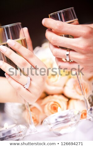 two elegant champagne glasses making toast stock photo © elisanth