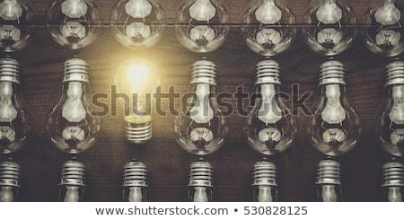 uniek · gloeilamp · heldere · licht · grijs · papier - stockfoto © ivelin