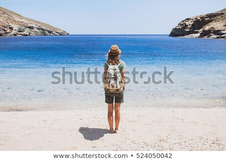 Young woman with a backpack admiring the scenery Stock photo © dash