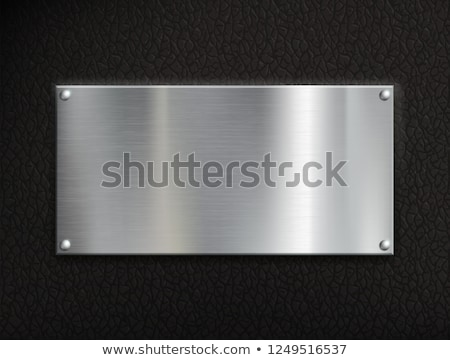 Metal plate on leather background Stock photo © kjpargeter