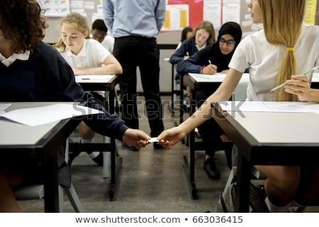 students passing a paper stock photo © zurijeta