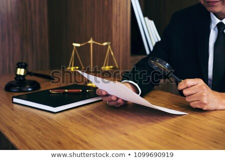 lawyer reading legal contract agreement stock photo © stevanovicigor