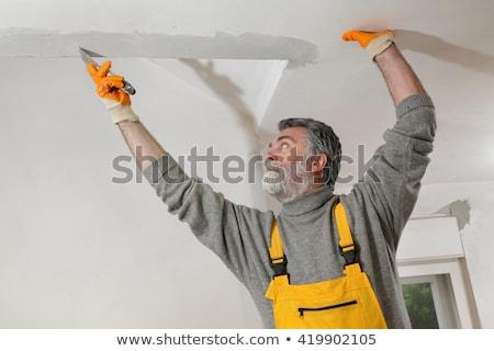 trabajador · yeso · techo · casa · construcción - foto stock © simazoran